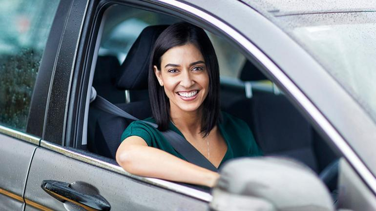 Women in car smiling