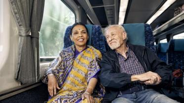 Pensioners on train smiling